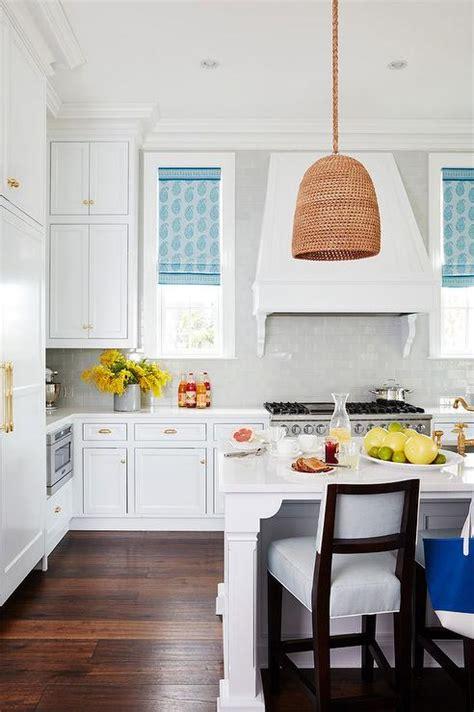 white kitchen  blue paisley roman shades cottage
