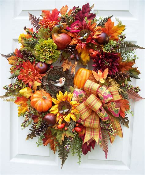 pin  timeless floral boutique  fall wreaths  swags
