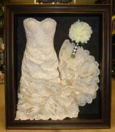 framed wedding dress and bouquet framed by floral With shadow box for wedding dress