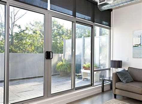 Sliding Entrance Doors by White Sliding Aluminum Door With A Large Glass For The