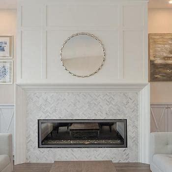 light gray fireplace mantle  dark gray herringbone