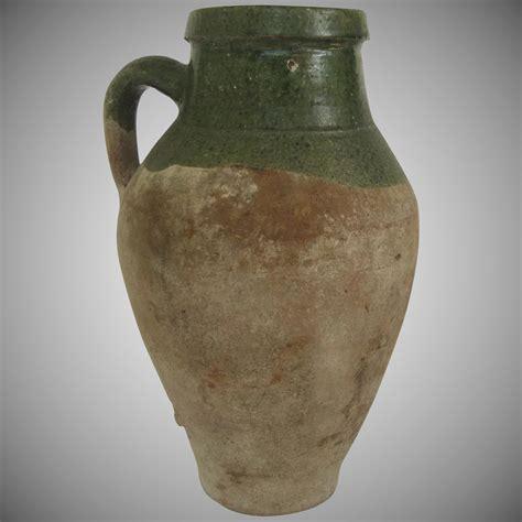 vintage pottery urn jug  handle green glazed lip