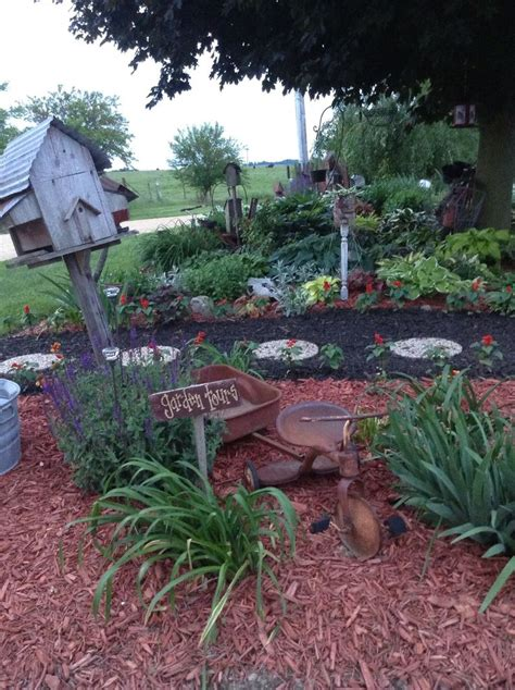 when to mulch flower beds in stepping stone path with black mulch red mulch in the flower beds old tricycle with wagon and