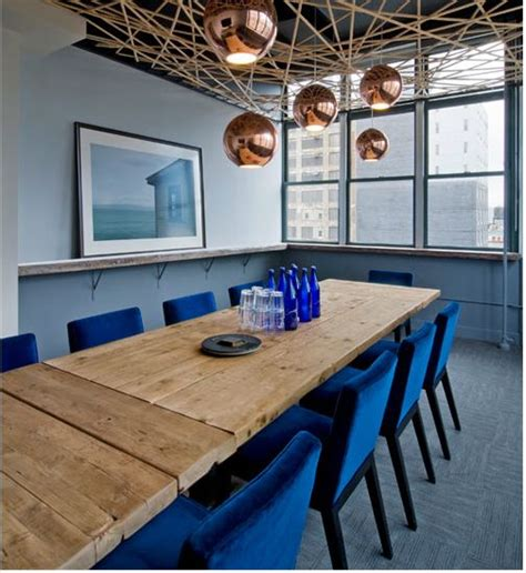 rustic conference room rustic conference table colorful chairs lighting cluster