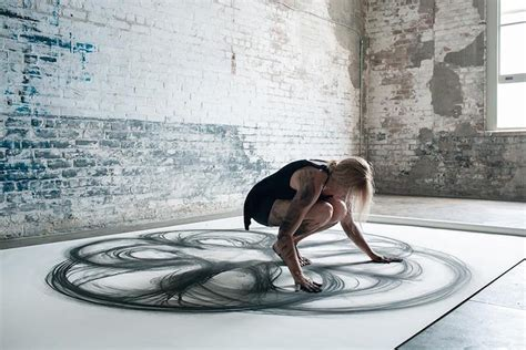dancer draws beautiful abstract paintings choreographed body movements