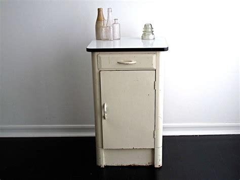 vintage enamel top kitchen cabinet vintage white metal cabinet with an enamel top via etsy 8830