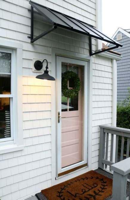 ideas black metal door curb appeal   porch awning garage door design door awnings