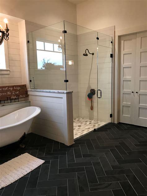 shiplap shower  herringbone honed slate floors farmhouse bathroom  transitional