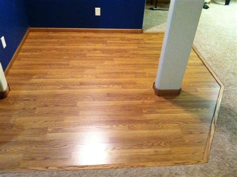 Laminate Floor Transitions To Carpet by Laminate Wood Flooring For Bar Project Materials Were