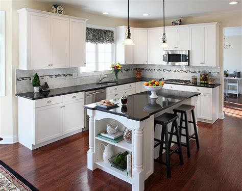 Kitchen With Black Countertops And White Cabinets