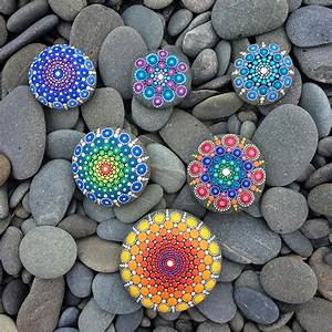 Artist Turns Ocean Stones Into Tiny Mandalas By Painting Colourful Dot Patterns