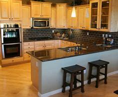white and kitchen cabinets white cabinets black subway tile black granite 1734