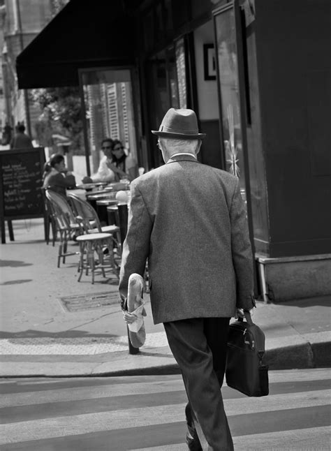 Well Dressed Man with Baguette by Larry Vogel | Susan