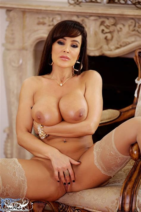 Lisa Ann Looks Hot In White Lingerie And Nude Stockings Picture