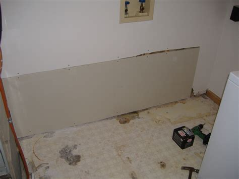 water damage repaired with ceramic tile and new drywall in