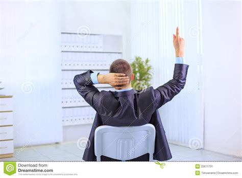 leaning back in the chair stock image image 22671731