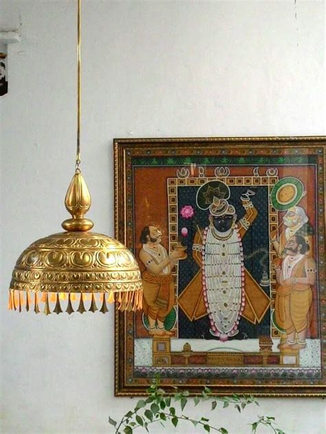 brass hanging l and my favourite a pichawai painting