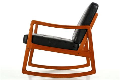 modern sculpted teak and leather rocking chair by