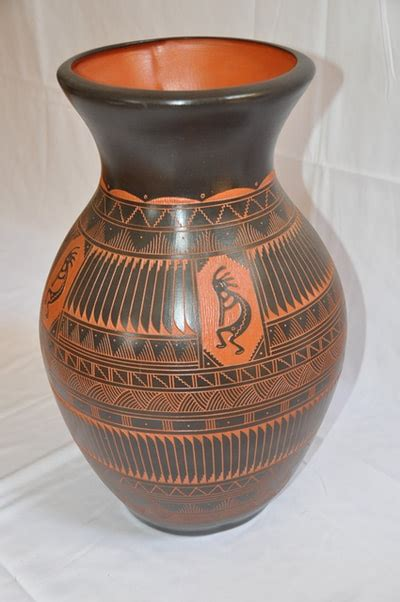 large brown colored navajo ceramic vase  hand etched