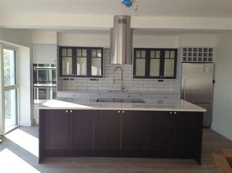 Industrial kitchen, white metro tiles, black grout, farrow