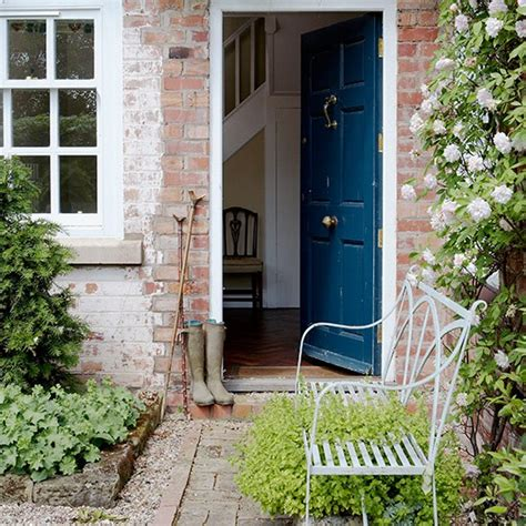 cottage garden with iron bench and rambling roses front