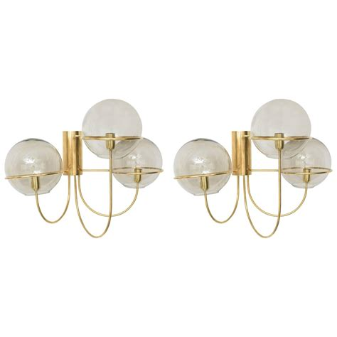 pair large mid century modern polished brass wall sconces