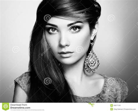 Portrait Of Beautiful Young Woman With Earring Jewelry