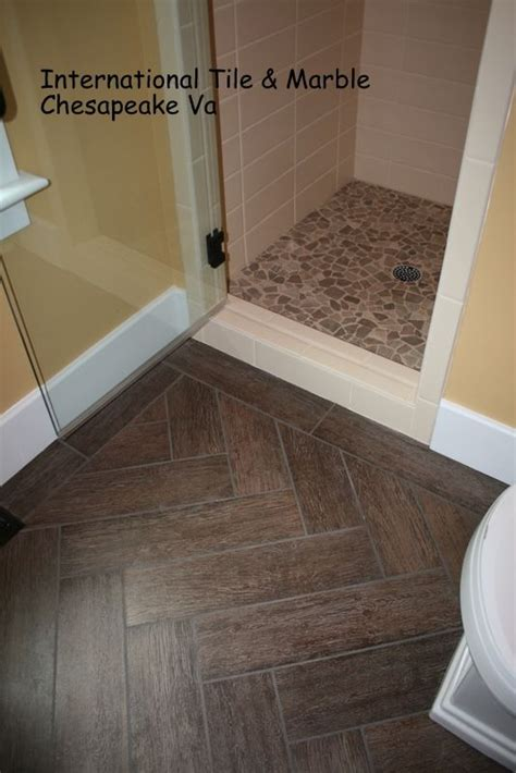wood grain porcelain floor tile herringbone layout
