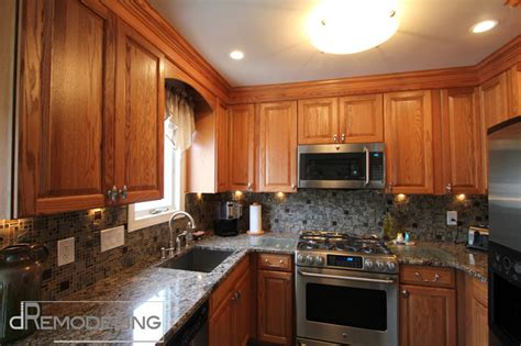 oak cabinets and mosaic backsplash traditional kitchen