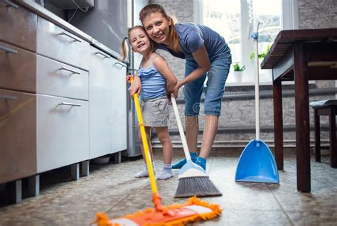Mother Daughter Wash The Floor At Home Stock Photo Chrome Tie Back Hooks For Curtains Shower Curtain Rods Sizes How To Hang A Scarf Valance On Rod Northside Blinds Adelaide Sa Some Ideas Bay Window Lord Of The Rings Much Fabric With Pinch Pleats Measurements Chart