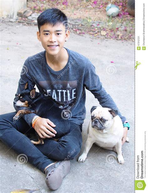Miniature Pinscher Pug Dog Boy Stock Image