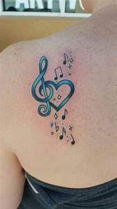 Turquoise treble clef with heart and notes tattoo on ...