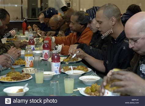 Homeless Men Eat At The New York City Rescue Mission Soup