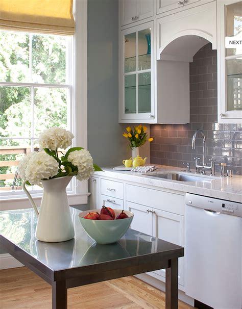 white cabinets gray walls gray subway tile backsplash contemporary kitchen