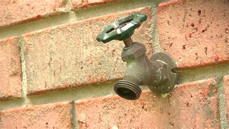 outdoor faucet leaking inside wall outdoor garden hose spigot protruding from a brick wall