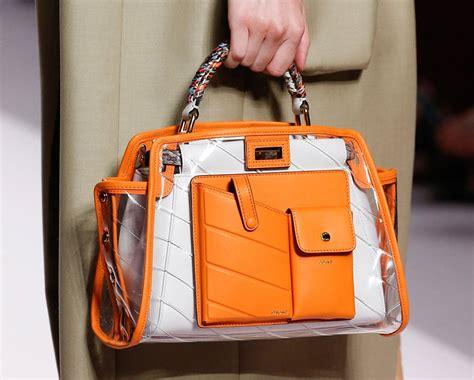 fendis spring  runway bags emphasize utility pockets  embossed leather logos purseblog