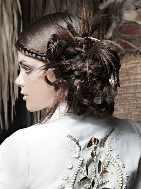 updo  combines smooth hair braids  feathers