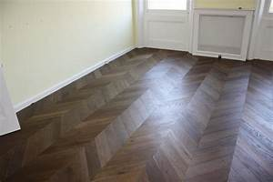 smoked oak engineered parquet flooring laid in a chevron With engineered wood flooring parquet