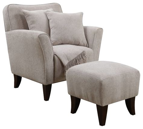 cozy accent chair with ottoman pillows and throw