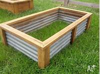 raised garden boxes Raised vegetable garden bed planter box recycled materials ...