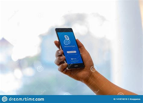 How to download free skype for huawei ascend p1. CHIANG MAI, THAILAND - Oct. 28,2018: Man Holding HUAWEI ...