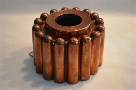 antique copper mold open center tin lined bullet shaped designs timber hills antiques