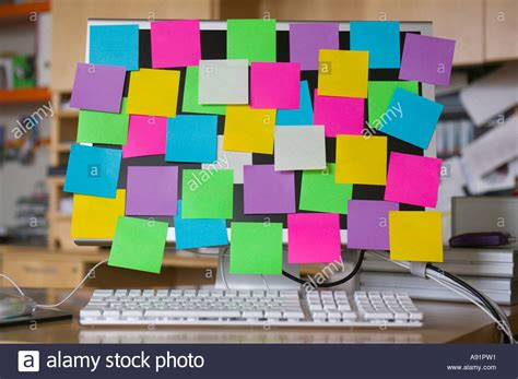 post it bureau pc post it notes on computer monitor stock photo royalty free image 6984208 alamy