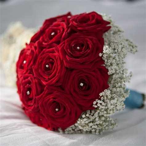 red rose bouquet  pearls gypsophila poppies florist
