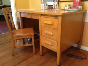 vintage wood school teachers desk and chair in los feliz