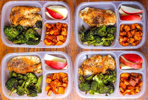 meal prep lunch bowls with spicy chicken roasted lemon broccoli and caramelized sweet potatoes