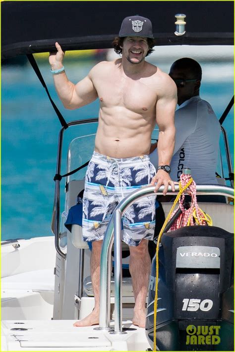 mark wahlberg shows  ripped shirtless body  barbados
