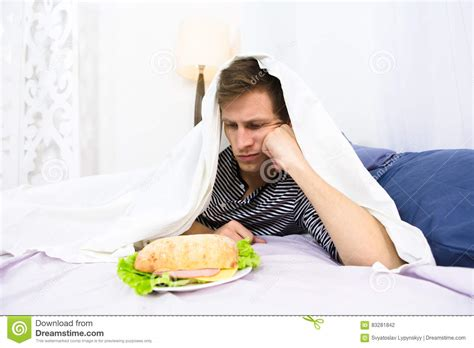 Single Man Eating In Bed Stock Photo. Image Of Male, Smile
