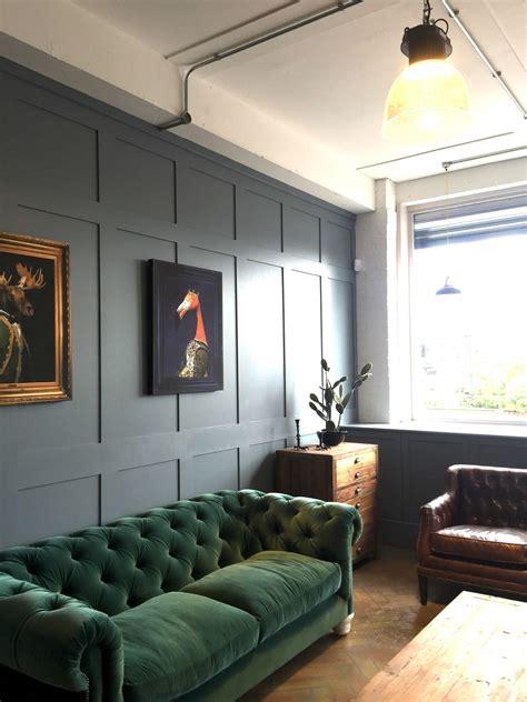 light filled living room  paneled warm gray walls