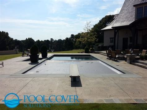 rectangular  ground backyard pool  diving board  tanning ledge pool cover key switch